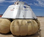 The CST 100 space capsule mockup with airbags deployed (Credits: Boeing).