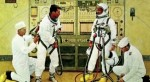 A painting of astronauts suiting up, by Norman Rockwell (Credits: NASA).