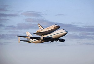 Shuttle Discovery flying on top of a Boeing 747 Shuttle Carrier Aircraft (Credits: NASA).