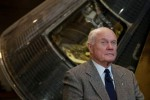 Former astronaut and US Senator John Glenn posing with the Friendship 7 capsule at the Washington DC Air and Space Museum in 2002 (Credits: Gannett News Service)