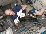 Astronaut Don Pettit, who returned from 6 months aboard ISS on July 1, prepares a biological sample for the freezer (Credits: NASA).