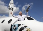 Richard Branson shows off a model of LauncherOne during his announcement (Credits: Mark Chivers).