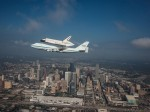 Endeavour flies over Houston aboard the Shuttle Carrier Aircraft. This photogrpah was captured by a NASA T-38 chase plane (Credits: NASA/Sheri Locke).