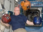 Astronaut Scott Kelly shows off the SPHERES satellites on ISS (Credits: NASA).