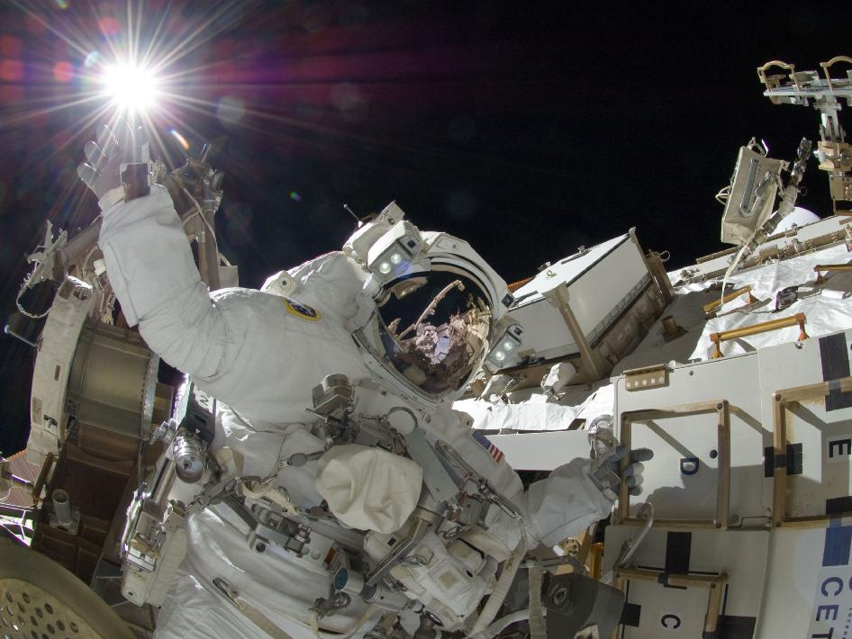 NASA astronaut Sunita Williams, Expedition 32 flight engineer, appears to touch the bright sun during the missions third session of extravehicular activity (EVA) on Sept. 5, 2012. Credits: NASA