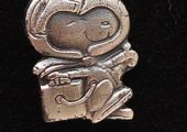 A Silver Snoopy pin (Source: WikiMedia).