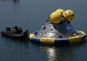 Rescue divers secure a flotation ring around a mockup of NASA's new Orion spacecraft during water splashdown tests in Florida in 2009 (Credits: NASA/Dmitri Gerondidakis).