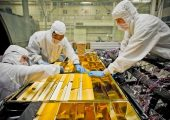 Adequate thermal insulation is critical to spacecraft operations. Here, engineers apply insulation blanketing to the James Webb telescope (Credits: NASA).