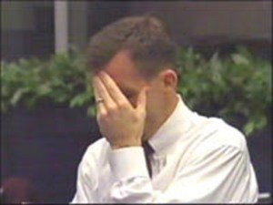 LeRoy E. Cain, STS-107 entry flight director, realizes the loss of Columbia (Credits: NASA).