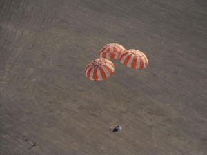 A July 2012 Orion drop test, using all three parachutes (Credits: NASA).