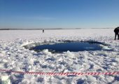 The hole in Lake Chebarkul formed by a meteorite fragment (Credits: Andrey Orlov/RT).