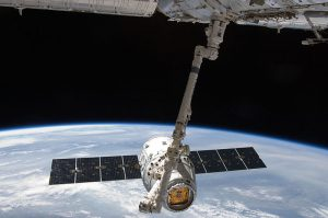 SpaceX's Dragon capsule and Candarm2, the robotic arm that will detach the capsule from the ISS (Credits: NASA).