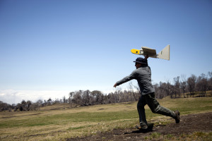 Ames research scientist Rick Kolyer launches Dragon Eye UAV. (Credits: NASA/ Randy Berthold)
