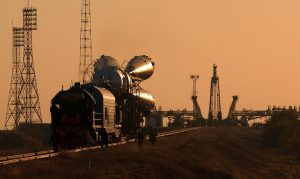 A Soyuz takes the train to the Baikonour launch pad (Credits: NASA).