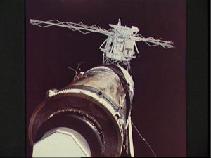 Although the deployment of the Apollo Telescope Mount (ATM), in the background, was considered relatively complex in terms of its criticality, no one could have foreseen that Skylab's solar arrays and micrometeoroid shield would almost ruin the mission. In this view from Pete Conrad's crew, the tattered wiring and tubing from the torn solar array are clearly visible (Credits: NASA).