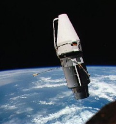 """With the """"jaws"""" of its docking collar shroud stuck partially open, the Augmented Target Docking Adaptor (ATDA) presented an alligator-like appearance to Tom Stafford and Gene Cernan (Credits: NASA)."""