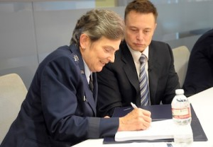Lt. Gen. Ellen Pawlikowski, commander of SMC, and SpaceX CEO Elon Musk signed a cooperative research and development agreement to help certify SpaceX's Falcon 9 rocket for military launches. Credit: U.S. Air Force/Joe Juarez