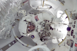 Astronaut James Reilly exiting ISS through the Quest airlock (Credits: NASA).