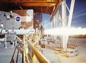 Test firing an American Rocket Company (AMROC) hybrid rocket motor at NASA's Stennis Space Center in 1994 (Credits: NASA).