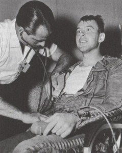 "A doctor examines Lt. Clifton ""Demi"" McClure after his Man High III mission. His parents nicknamed him Demi after he was born on the night Franklin D. Roosevelt, a Democrat, was first elected president (Credits: USAF)."