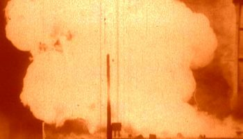 The explosion of the R-16's first stage fuel supply fed a ferocious fire (Credits: USSR).