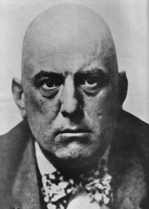 Aleister Crowley, looking quite evil. (Public domain image).