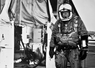 Then-Capt. Joseph Kittinger stands next to the Excelsior gondola which, supported by a helium balloon, carried him 102,800 feet above Earth. Kittinger set historical records for highest balloon ascent, highest parachute jump, longest drogue fall and fastest speed by a human being through the atmosphere. The 52-year-old records stood until last fall when an effort aided by Kittinger himself broke his records (Credits: U.S. Air Force photo).