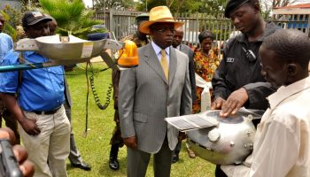 Pictured on the right, Chris Nsamba shows off his space probe to the prime minister of Uganda Amama Mbabazi. (Photo credit ugandanway.com)