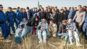 Christopher Cassidy, Pavel Vinogradov, and Alexander Misurkin rest after landing in a malfunctioning Soyuz TMA-08M (Credits: NASA).