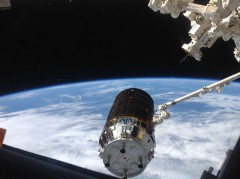 "The HTV-4 ""Kounotori"" (""White Stork"") cargo craft is captured by the station's Canadarm2 on 9 August (Credits: NASA)."