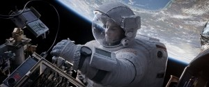 "Ryan Stone (Sandra Bullock) works on Hubble in the movie ""Gravity"" (Credits: Warner Bros.)."