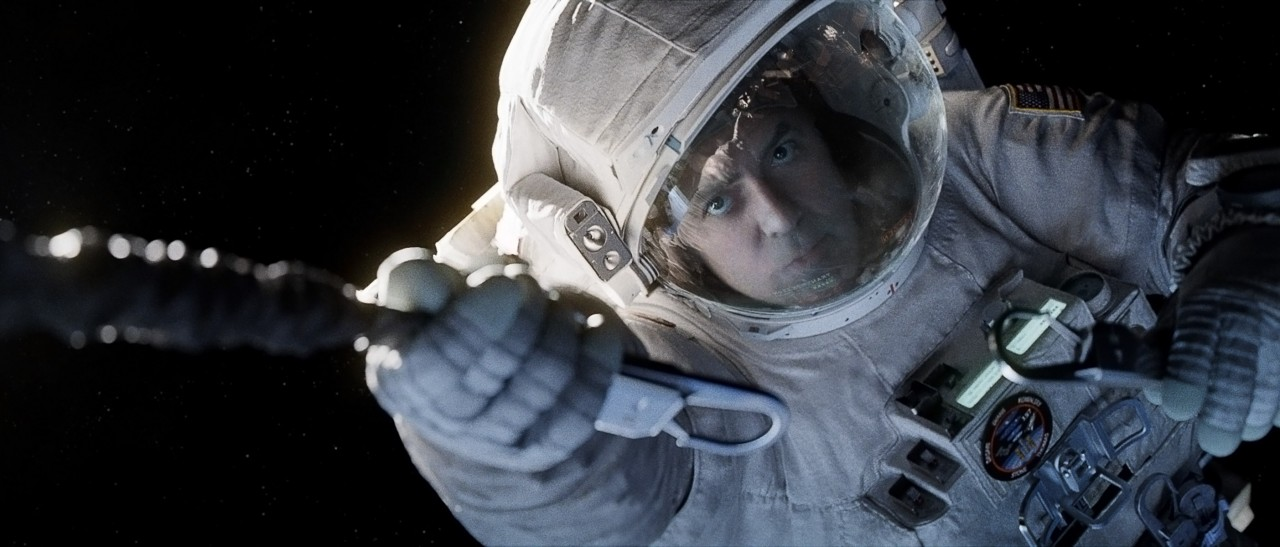 """Gravity"" astornaut Matt Kowalski (George Clooney) releases his tether before floating off into space (Credits: Warner Bros.)."