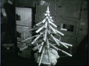 The makeshift Christmas tree built by Carr, Gibson, and Pogue from old food containers and packaging also included a long-tailed star at its tip: Comet Kohoutek (Credits: NASA).