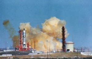 Clouds of smoke hang ominously around Pad 19 as Gemini VI's Titan sits motionless in the seconds after the abort. Note the absence of an escape tower atop the Titan; in an emergency, Schirra and Stafford would have used ejection seats. Many astronauts doubted the reliability and survivability of the seats, which factored into Schirra's decision not to use them that day (Credits: NASA).