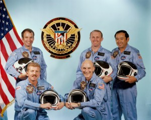 Since the conception of the manned spaceflight engineer programme, the intent was to fly a dedicated officer aboard each classified flight. For Mission 51C, it would be Air Force Major Gary Payton (back left). The other NASA crew members were Loren Shriver (front left) and Ken Mattingly (front right), with Jim Buchli and Ellison Onizuka behind (Credits: NASA).