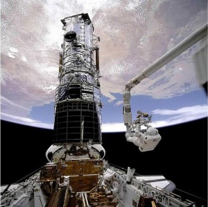 Musgrave is anchored on the end of the Remote Manipulator System arm during STS-61, Hubble's first servicing mission (Credits: NASA).