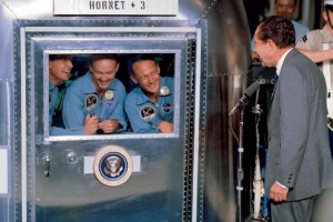 President Nixon speaks with the Apollo 11 crew,  in quarantine after their historic mission (Credits: NASA).