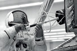 Fred Haise extracts the fuel element for the Apollo 13 SNAP-26 RTG