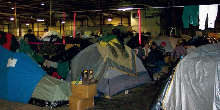 Columbia recovery volunteers camp in a warehouse