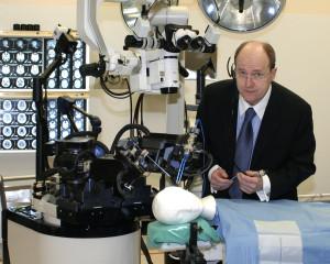 Dr. Garnette Sutherland with neuroArm (Credits: Ken Bendiktsen / University of Calgary)