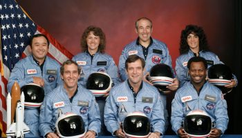 The crew of Space Shuttle mission STS-51-L. In the back row from left to right: Ellison S. Onizuka, Sharon Christa McAuliffe, Greg Jarvis, and Judy Resnik. In the front row from left to right: Michael J. Smith, Dick Scobee, and Ron McNair. Credits: NASA