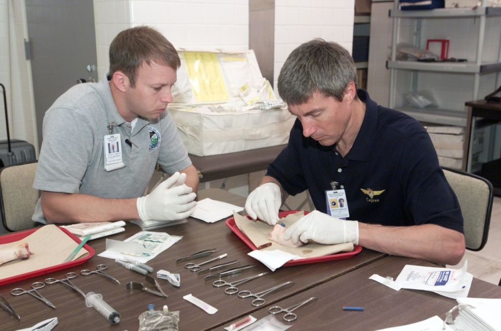 Tyler N. Carrith (left) trains  cosmonaut Sergei K. Krikalev (right) in medical procedures