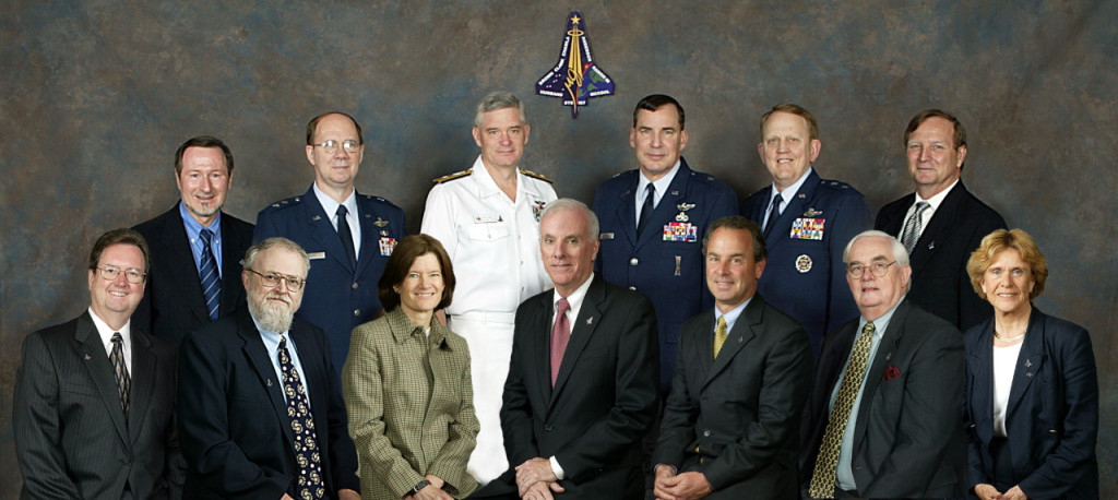The Columbia Accident Investigation Board. From left to right seated are board members Roger E. Tetrault, Dr. James N. Hallock, Board Chairman Admiral (retired) Hal Gehman, Dr. Sheila Widnall, Dr. Douglas D. Osheroff. Standing from left to right are Rear Admiral Stephen Turcotte, Brig. General Duane Deal, Maj. General Kenneth W. Hess, Dr. Sally Ride, Steven Wallace, Dr. John Logsdon, Maj. General John Barry, and G. Scott Hubbard.