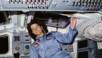 STS-7 Mission Specialist Sally Ride poses on aft flight deck with her back to the on orbit station (Credit: NASA).