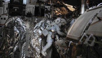 Luca Parmitano works on the routing of data and Ethernet cables during EVA-23 (Credits: NASA).