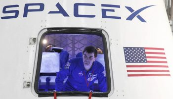 NASA astronaut Rex Walheim checks out Dragon's crew accommodations in 2012 (Credits: NASA).