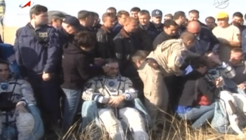 Cassidy, Vinogradov, and Misurkin just after extraction from their Soyuz TMA-08M (Credits: NASA TV).