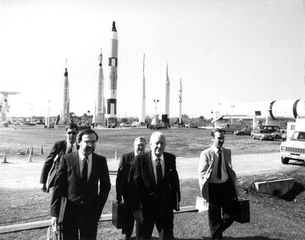 Here, Alton Keel (left), the representative to the Commission from the Executive Office of the President, and chairman William Rogers (center) arrive at the Galaxie Theatre at KSC's Visitor's Information Center for a one day briefing and tour of the NASA facility.